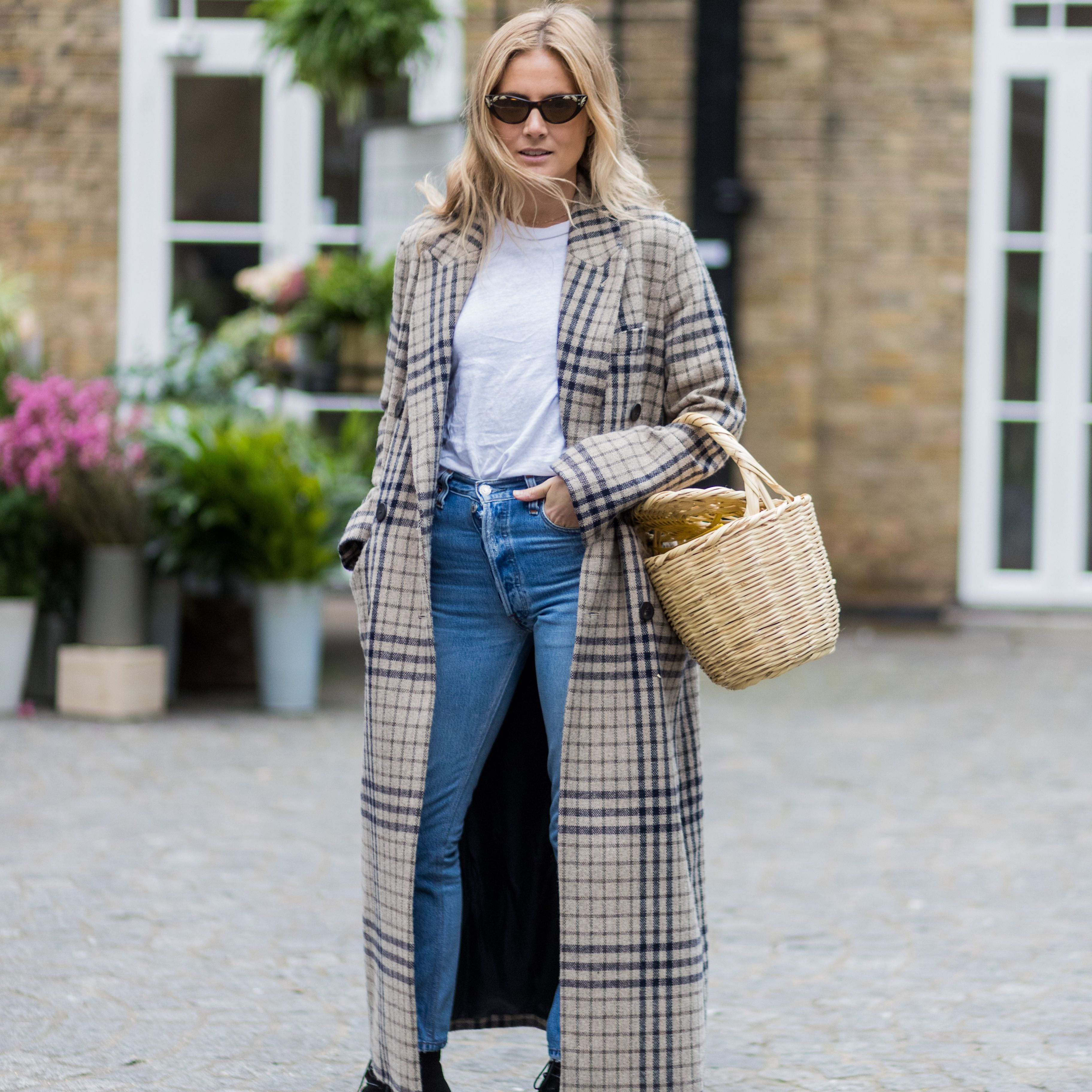 d09dbd6fc Street style woman in plaid coat and jeans and t-shirt