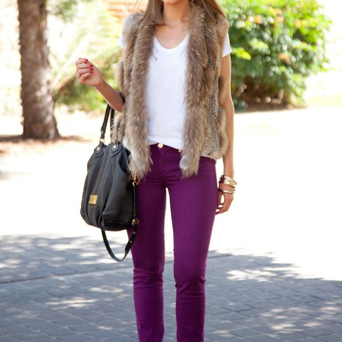 Woman wearing purple jeans and faux fur vest