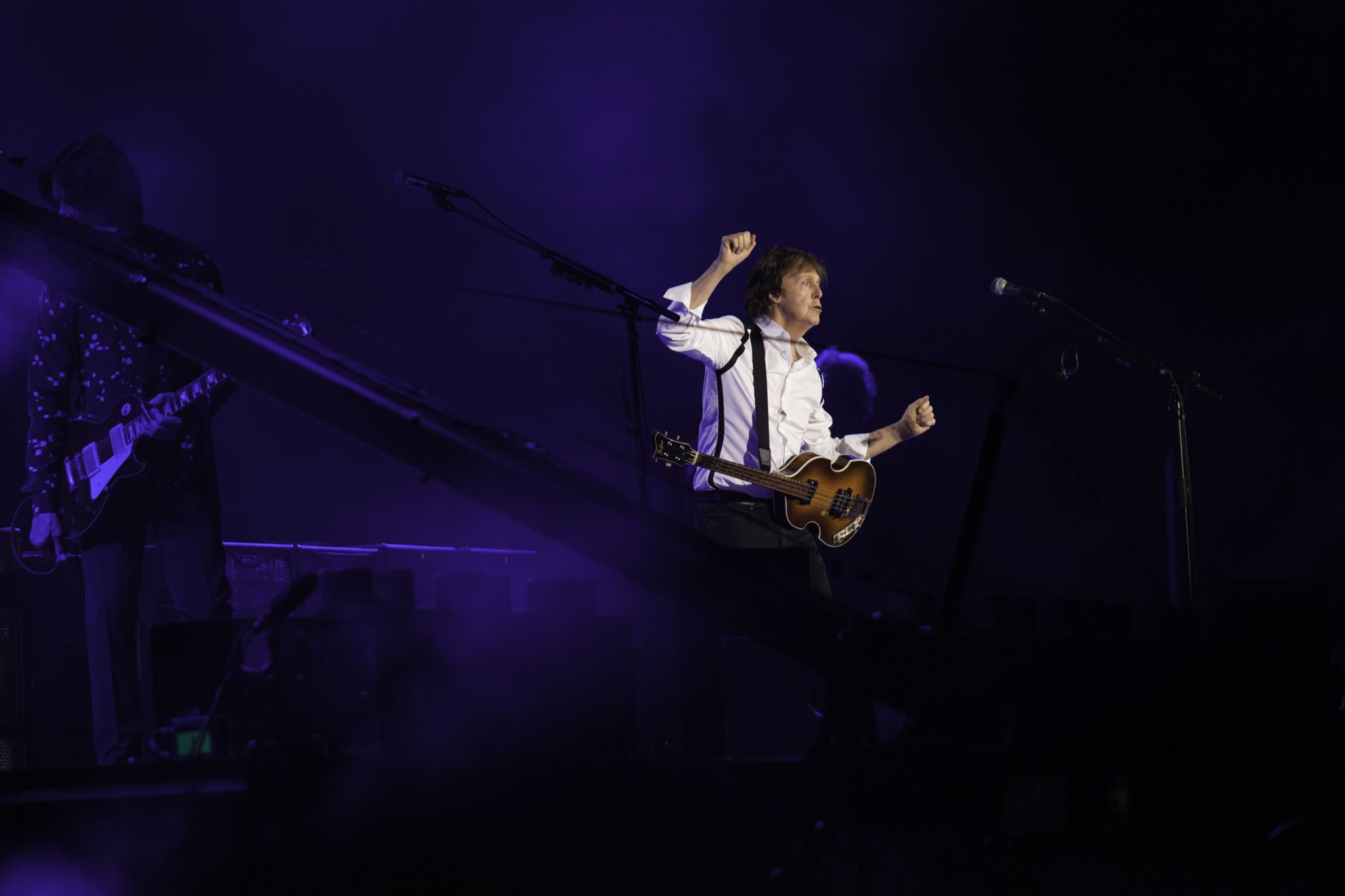 Paul McCartney performing live on stage.