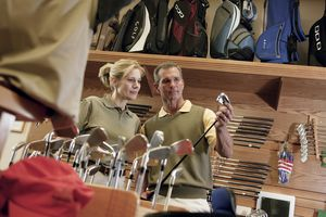 Man and woman shopping for golf clubs