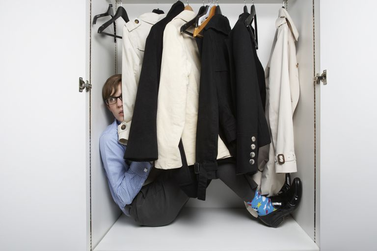 a person sitting in a closet