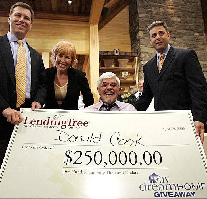 Donald P. Cook, winner of HGTV's 2006 Dream Home Sweepstakes, receives his check.