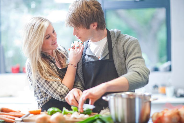 Young couple preparing food