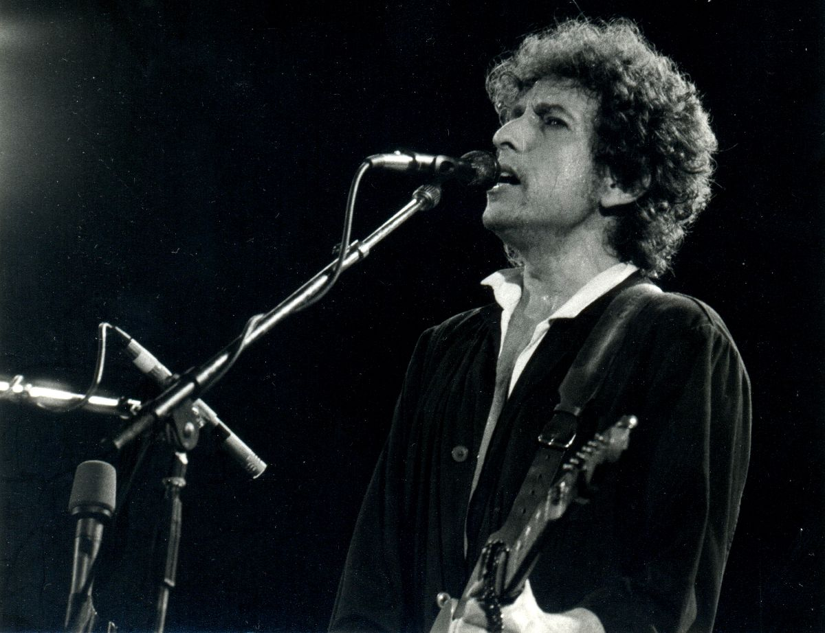 Black and white photo of Bob Dylan performing.