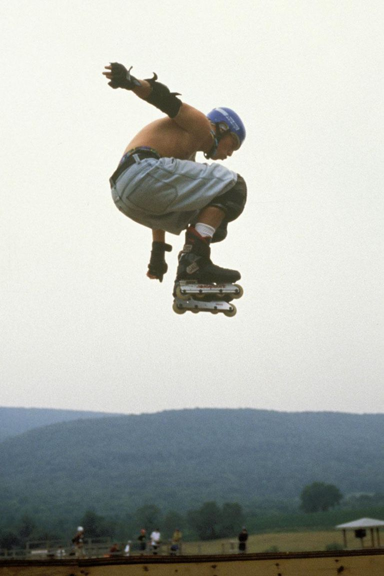 Inline skater jumping in air