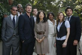 The cast of Grey's Anatomy posing together.