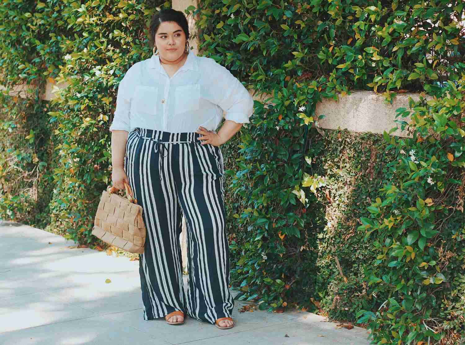 Woman in white shirt and striped pants for summer fashion