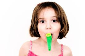 Green kazoo in girl mouth