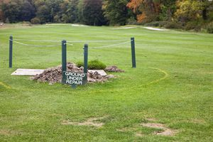 Ground under repair in a fairway on a golf course