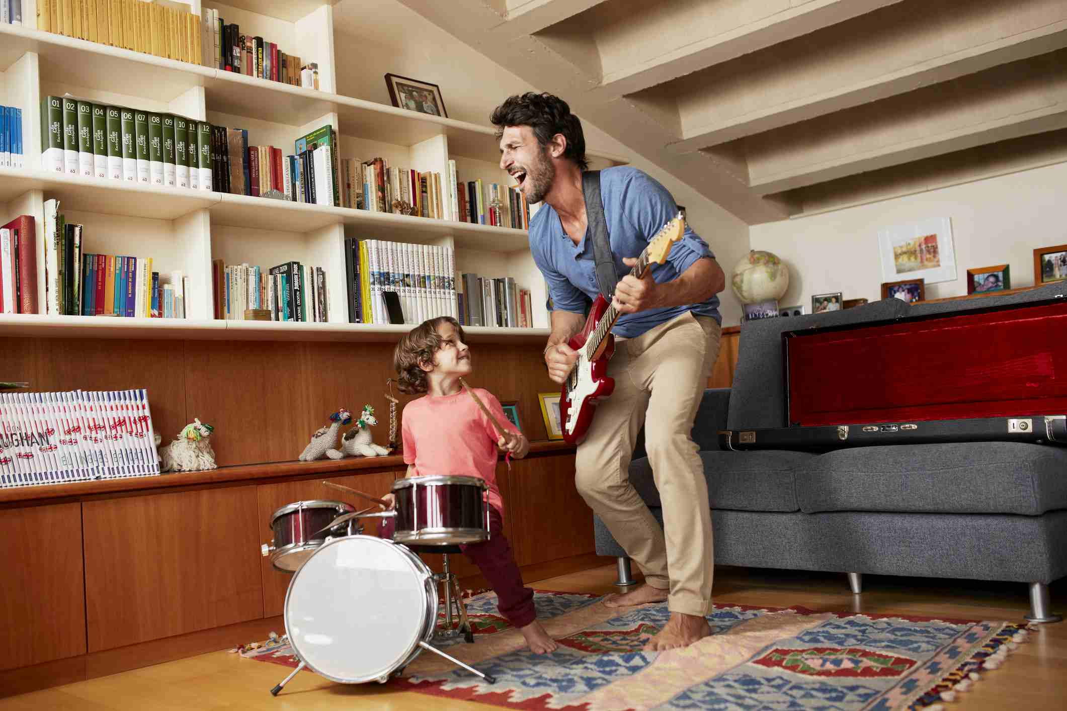 Father and son playing musical instruments