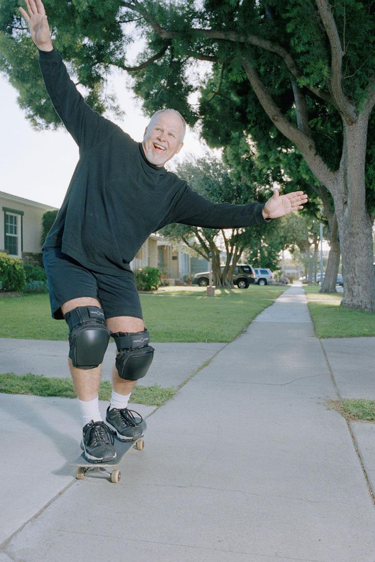 Elderly Man on Skateboard