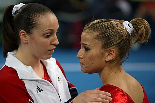 Gymnast Chellsie Memmel consoles teammate Alicia Sacramone during the Olympic gymnastics team finals