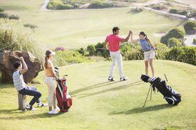 Team of four golfers