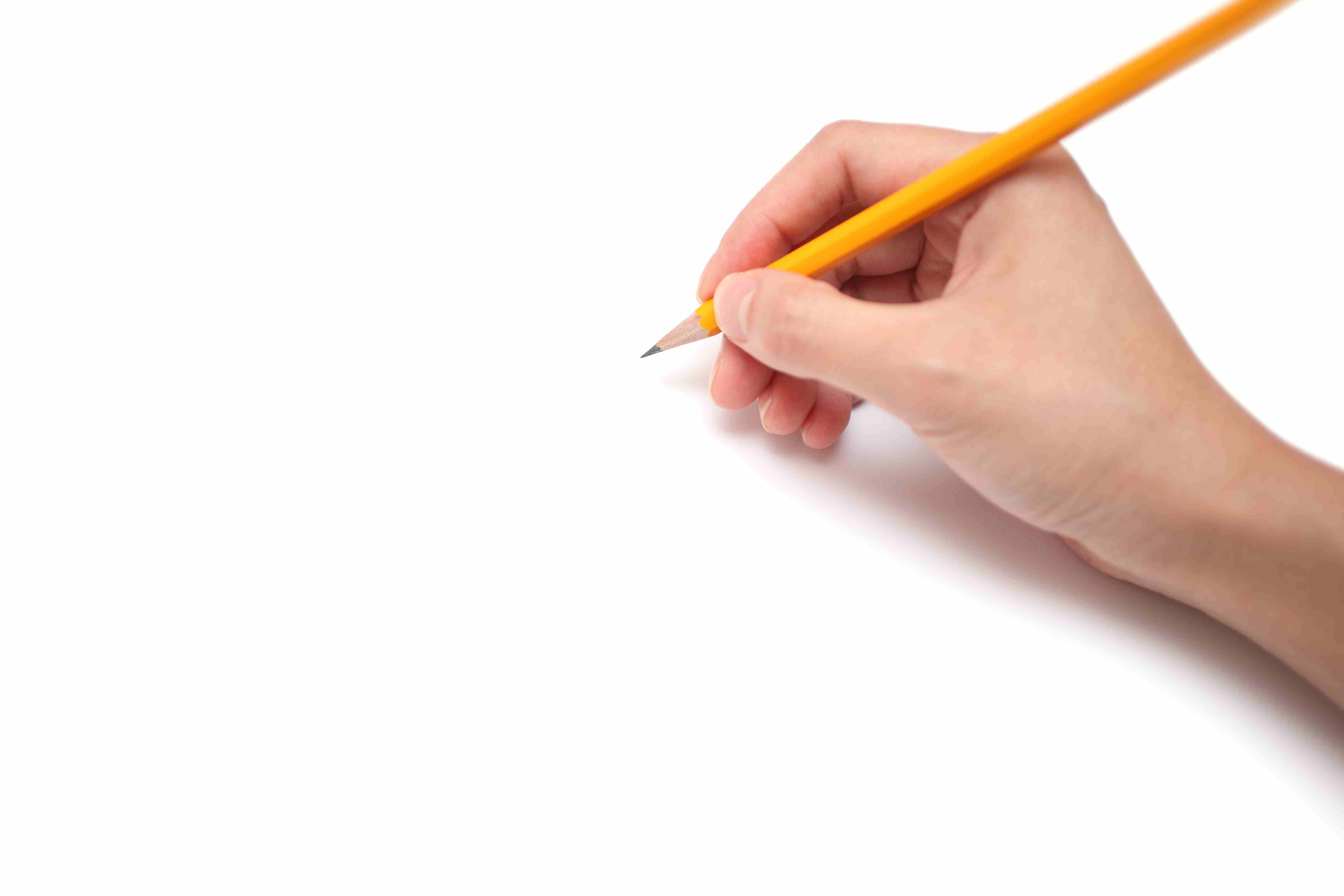 A hand is holding a pencil ready to draw, isolated on white background