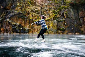 Figure Skater Spinning On Frozen Lake