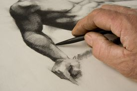 Artist's hand and sketch.