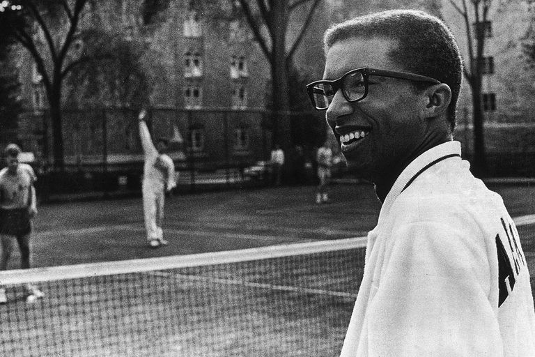 Arthur Ashe surveys the courts while cadets practice, New York, 1968.