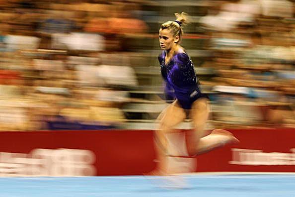 Alicia Sacramone runs down the vault runway