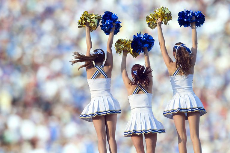 backs of cheerleaders in formation