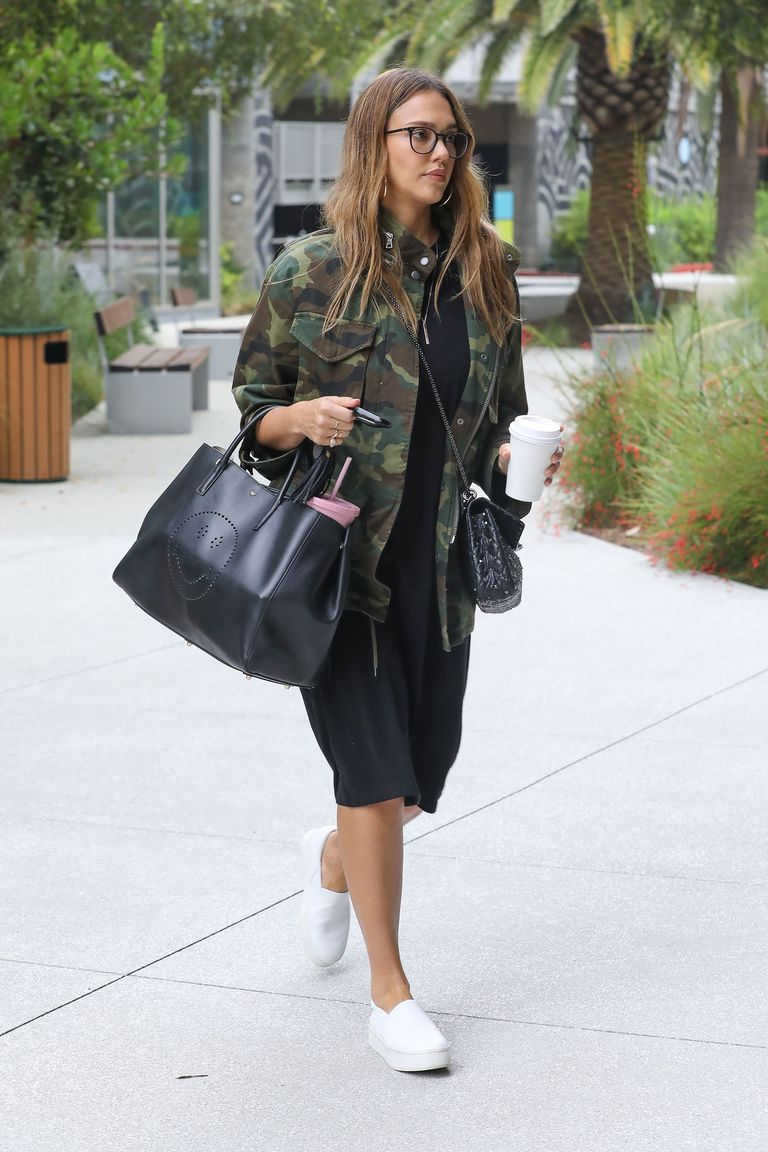 95da4c80d90 Fall or Winter Outfit for Daytime. Woman in camouflage print jacket and  black dress and sneakers