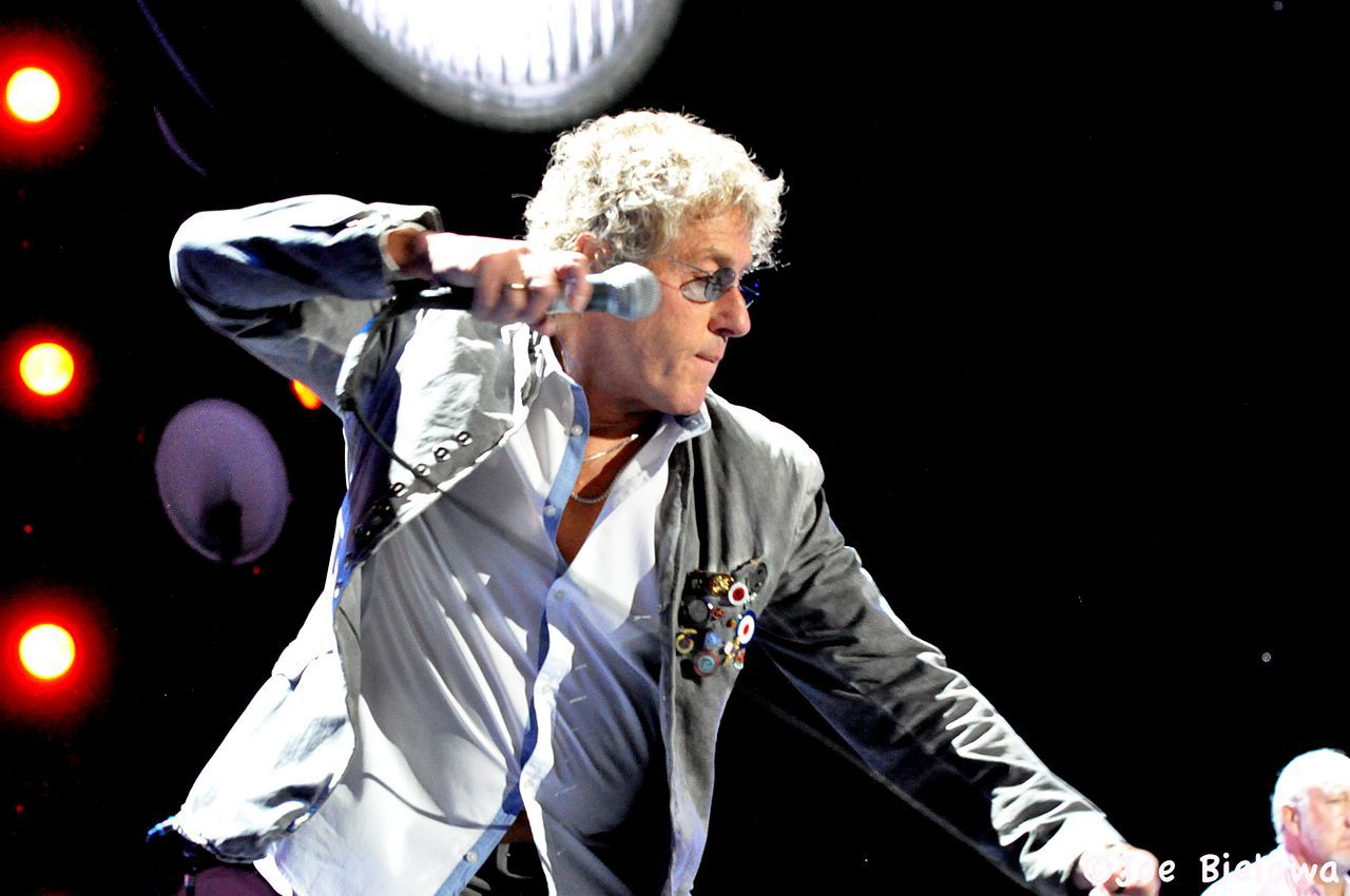 Roger Daltry performing on stage with The Who.