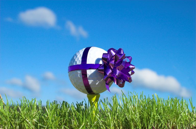 Golf ball with a bow on it