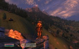 A man stands on a cliff overlooking some hills in Elder Scrolls IV: Oblivion.