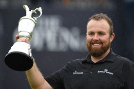 Ireland's Shane Lowry poses with the Claret Jug after winning the 2019 Open Championship.