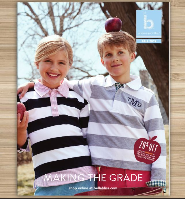 Two kids wearing striped shirts on the cover of the Bella Bliss catalog