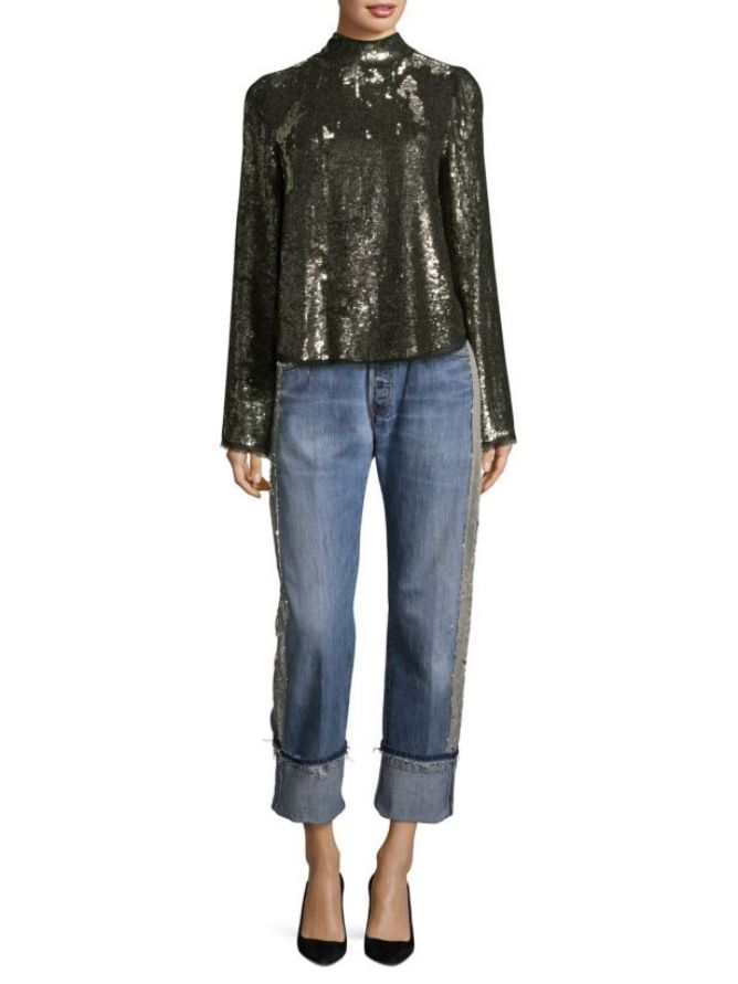 724f8e71a9 Casual New Year s Party Outfit. Woman in sequin top and straight leg jeans