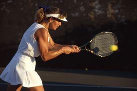 Woman hitting a tennis ball