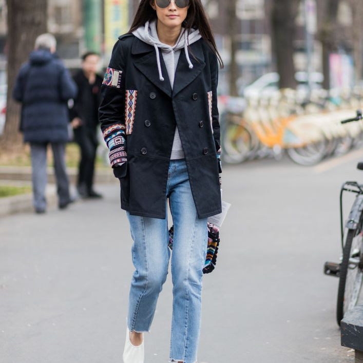 Street style woman in jeans and sweatshirt