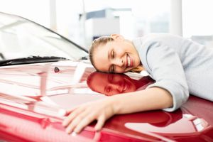 Young Woman Embracing Her New Car