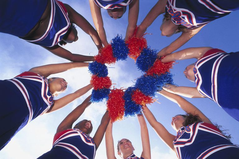 Cheerleaders Holding Pom-Poms