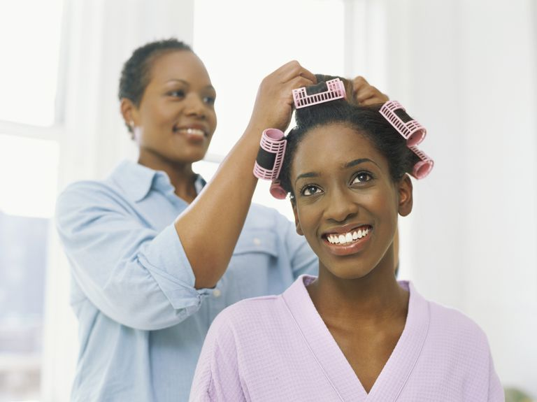 Roller setting is a great way to straighten natural locks without heat.