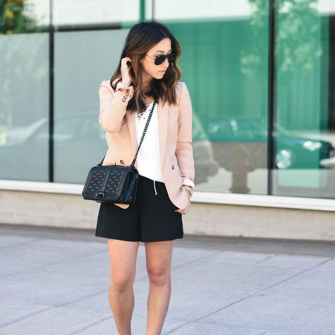 Woman in pink jacket and black skirt