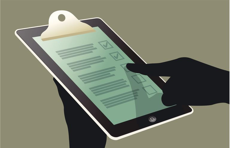 Close up of hand using checklist on digital tablet