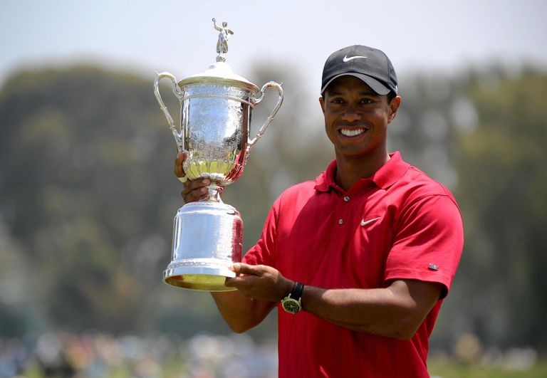 Tiger Woods holds his trophy after defeating Rocco Mediate in the playoff at the 2008 U.S. Open golf tournament.