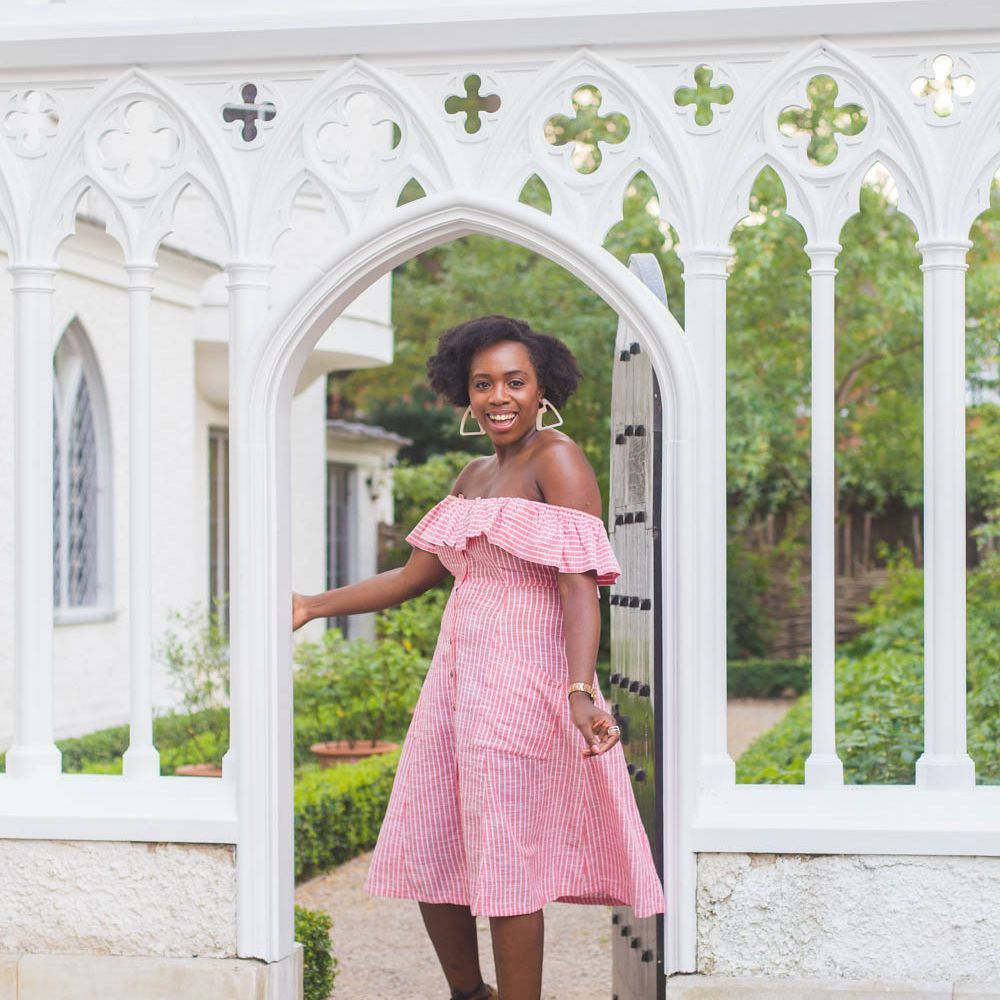Woman in pink gingham print dress