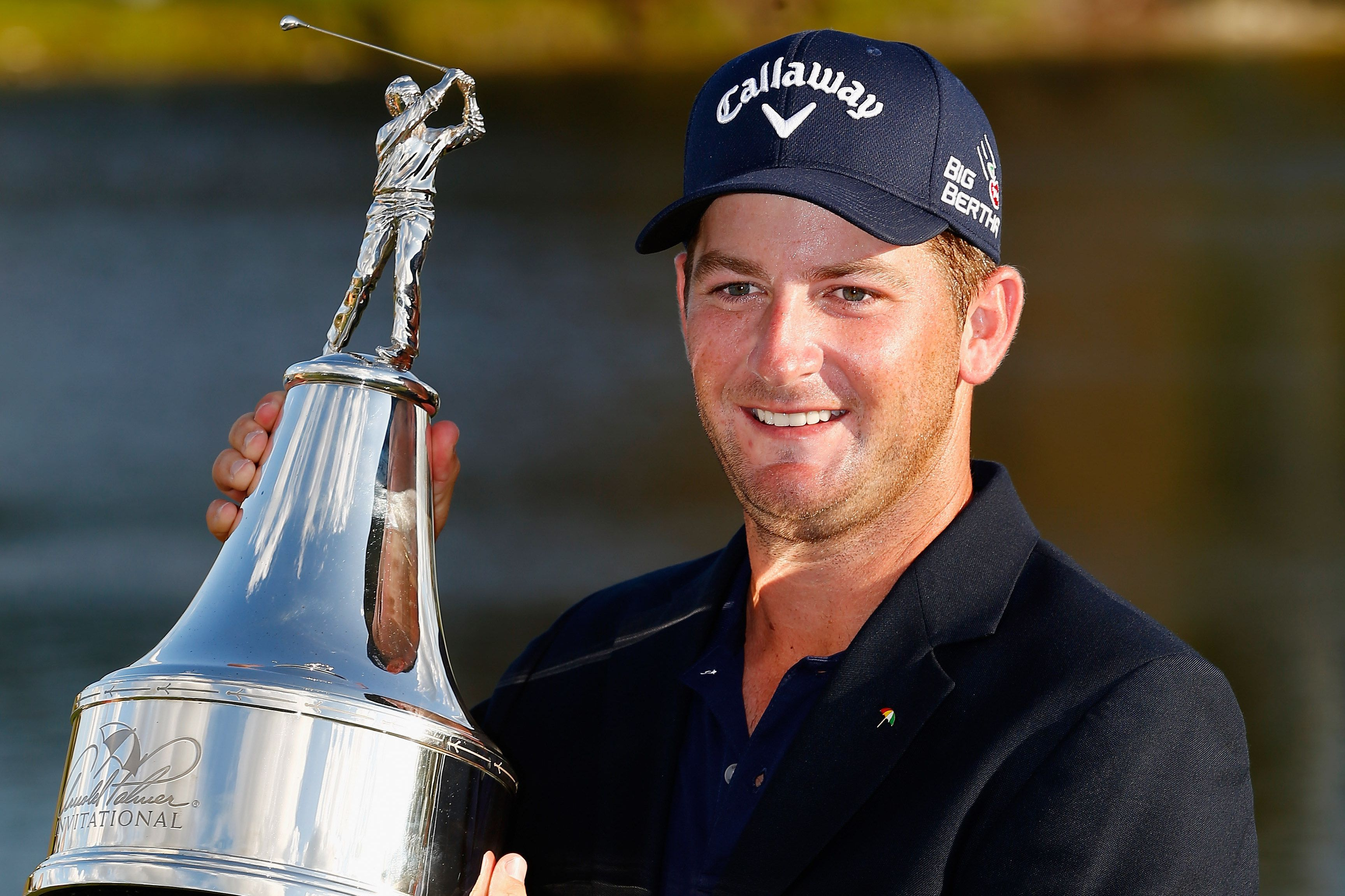 Matt Every of the United States celebrates with the trophy after winning the Arnold Palmer Invitational