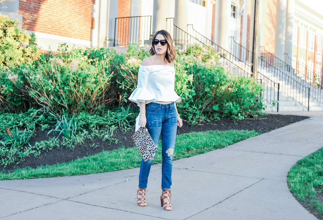 Woman in Off the Shoulder Top and Ankle Jeans