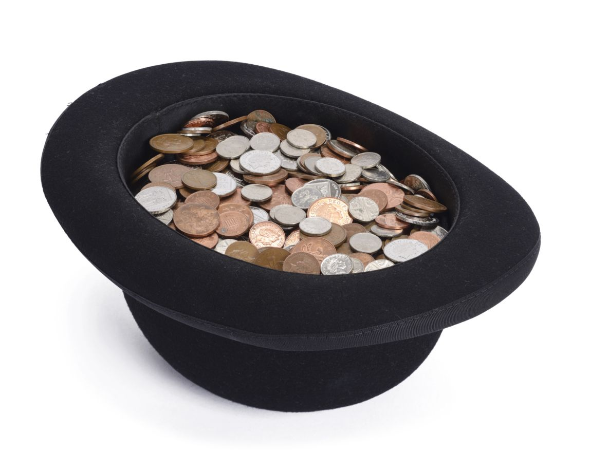 Photo of a bowler hat filled with money.