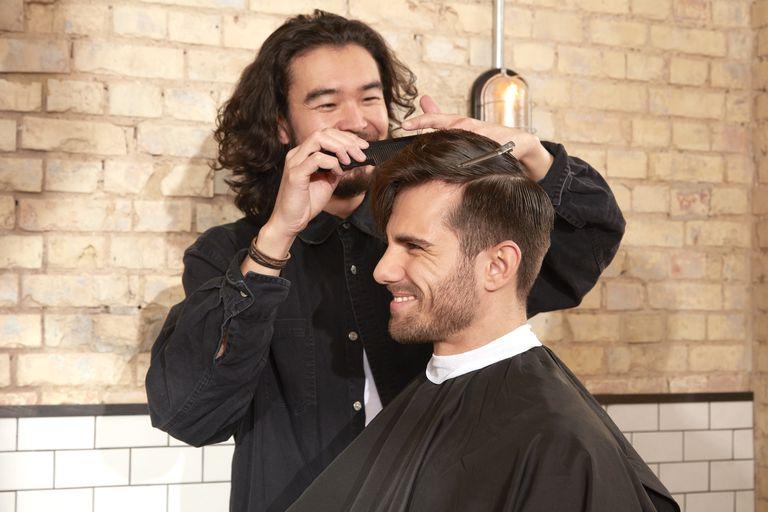 Barber cutting clients hair.