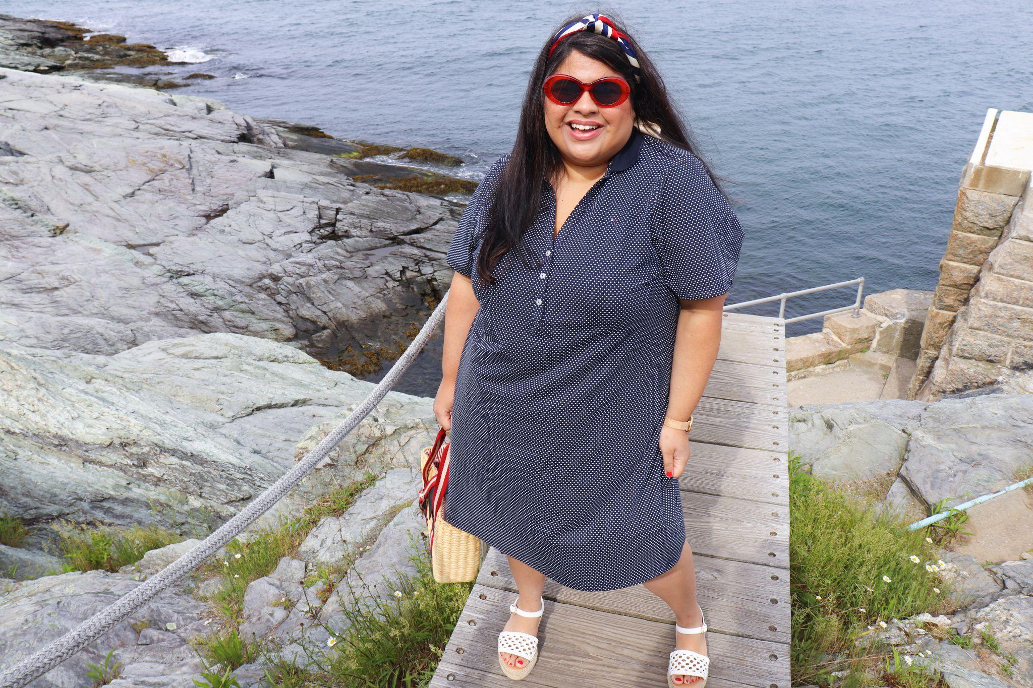 Plus size woman in tshirt dress at beach