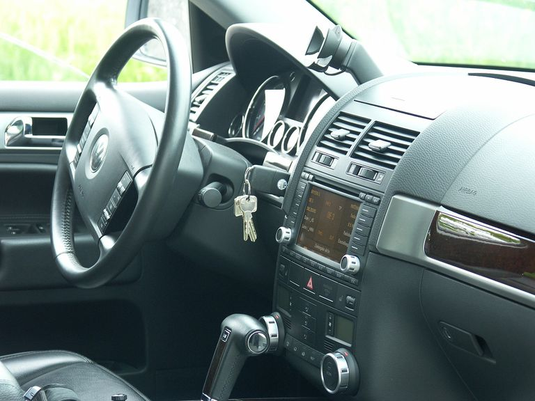 Car interior with keys in the ignition.