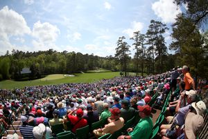 Fans watch play at Amen Corner during the second round of the 2013 Masters Tournament at Augusta National Golf Club
