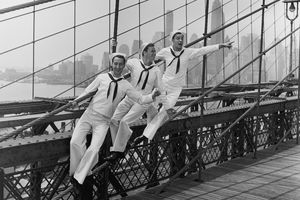 """American actors Jules Munshin, Frank Sinatra and Gene Kelly standing on the Brooklyn Bridge in a still from """"On The Town"""""""