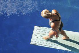 Diver steps onto the springboard