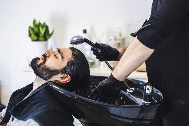 Man having his hair washed in a salon