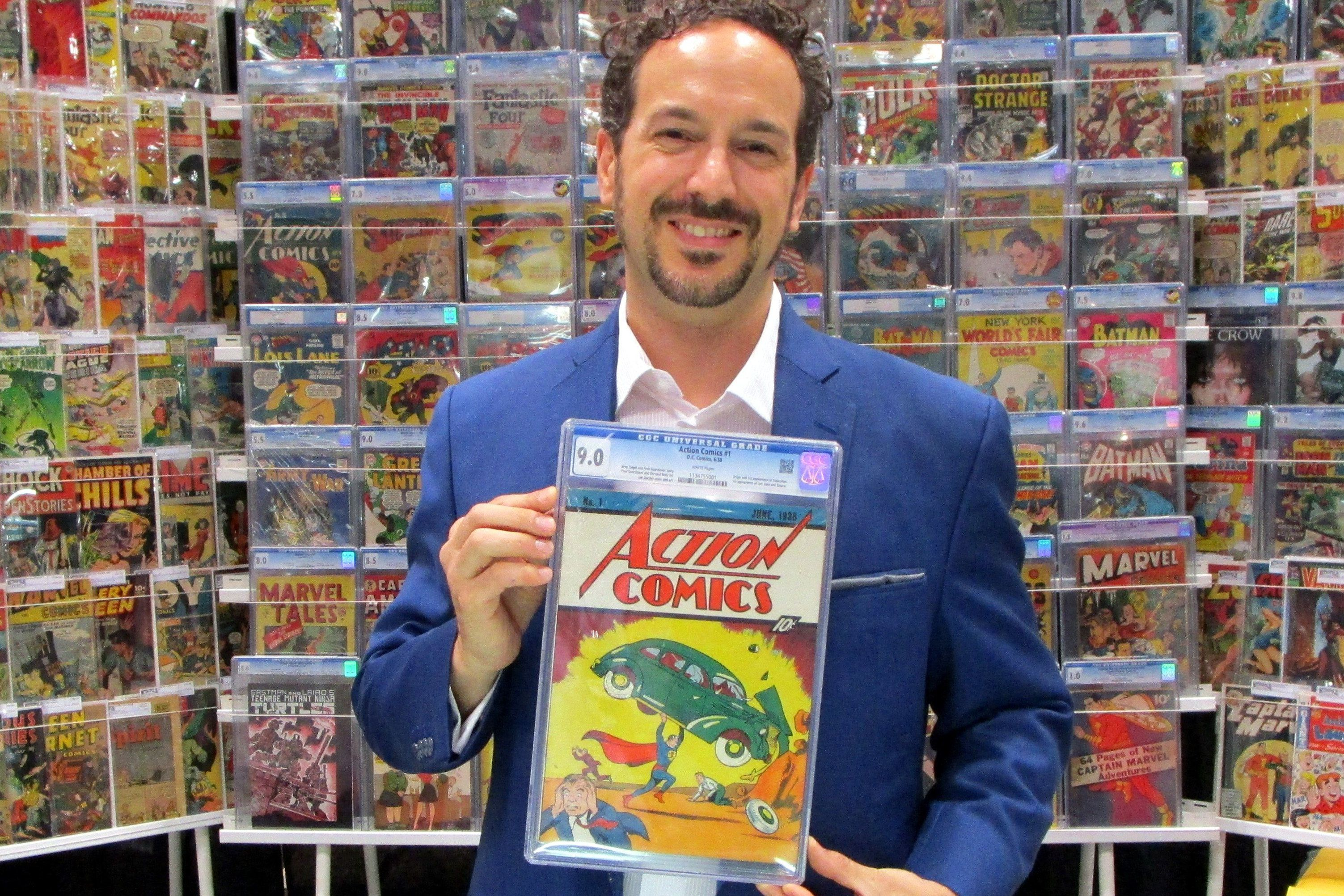 Man holding a copy of Action Comics in a comic store